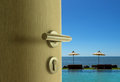 The door open to sea view in blue sky Royalty Free Stock Photo