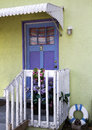 Door and porch a brightly colored doorway accents the of a home Stock Photo