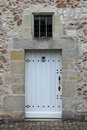 The door of a stone house in Saché, France, was painted in white Royalty Free Stock Photo