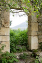 Door to paradise outdoor shot of an ancient stone in the middle of a forest Royalty Free Stock Photography