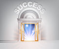 Door to success concept of a fantastic white marble with columns with light streaming through it Stock Image