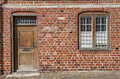 Door and window on red brick wall Royalty Free Stock Photo
