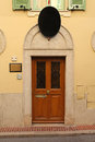 Door wooden with arch in old monaco Royalty Free Stock Photos