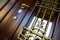 Door wooden with forged metal grate Stock Photo