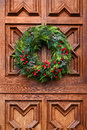 Door wreath christmas on the wood red Royalty Free Stock Photography