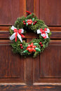 Door wreath christmas on the wood red Royalty Free Stock Photos