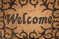 Doormat greeting welcome sign floor mat doorstep porch entrance Royalty Free Stock Image
