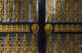 Doors with decoration iron decorations in golden color Stock Photos