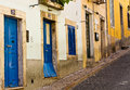 Doors on the street going uphill old of house in lisbon portugal Royalty Free Stock Image