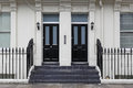 Doors two black at victorian house in london Stock Image