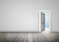 Doorway opening to blue sky in grey room with wooden floorboards Royalty Free Stock Photo