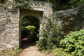 Doorway through to a lush green garden Stock Photography