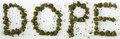 Dope spelled with marijuana the word out real Royalty Free Stock Photography