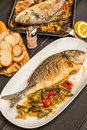 Dorada with okra and tomatoes Royalty Free Stock Photo