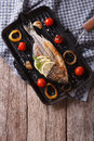 Dorado fish cooking on the grill pan close-up. vertical top view Royalty Free Stock Photo