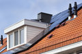 Dormer and solar panels Royalty Free Stock Photo