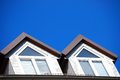 Dormer there are two dormers and a blue sky Royalty Free Stock Images