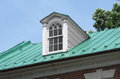 Dormer window on roof single the old sloping green copper of a house Royalty Free Stock Photography