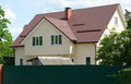 Dormer windows on metal roof. Metal Roofing. Royalty Free Stock Photo