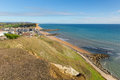Dorset coast West Bay uk view to east of the Jurassic coast on a beautiful summer day with blue sky Royalty Free Stock Photo