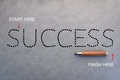 Dot line game success word with sharp pencil on grey background. Royalty Free Stock Photo