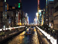 Dotonbori canal at night in osaka japan the famous city of lots of lights and lanterns a touristic boat is moving the water Royalty Free Stock Images