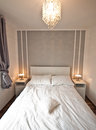 Double bed with white sheets and bedside lamps Royalty Free Stock Photography