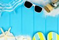 Double border of beach items and seashells on blue wood Royalty Free Stock Photo