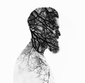 Double bw exposure portrait of a bearded guy and tree Royalty Free Stock Image