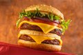 Double cheeseburger classic with two grilled beef patties Royalty Free Stock Photo