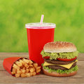 Double cheeseburger combo meal with french fries and cola a drink Stock Photography