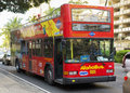 Double decker bus gives visitors tour honolulu showing off landmarks important places around town Stock Images