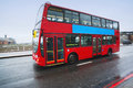Double decker bus in london travelling with a on s streets Royalty Free Stock Photo