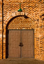 Double doors on brick wall Royalty Free Stock Image