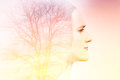 Double exposure of beautiful woman with tree Royalty Free Stock Photo