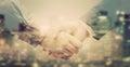 Double exposure of business people handshake on big city background Royalty Free Stock Photo