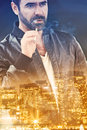 Double exposure of cityscape at night and man smoking Royalty Free Stock Photo