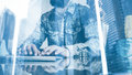 Double exposure concept.Bearded man working in the office.Coworker typing at a computer keyboard.Woman holding Royalty Free Stock Photo