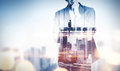 Double exposure concept with thinking businessman and city. With Royalty Free Stock Photo