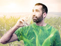Double exposure of man drinking water and field Royalty Free Stock Photo