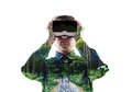 Double exposure. Man wearing virtual reality goggles. Forest. Tr Royalty Free Stock Photo