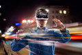 Double exposure, man wearing virtual reality goggles, night city Royalty Free Stock Photo