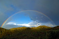 Double full rainbow over rolling hills mediterranean landscape Royalty Free Stock Photo