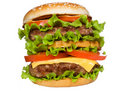Double hamburger with vegetables Royalty Free Stock Photos