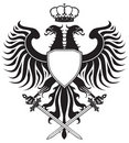 Double-headed eagle with crown and swords Royalty Free Stock Photo