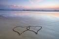 Double heart shape on the beach Royalty Free Stock Photo