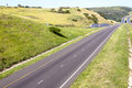 Double lane highway disappearing into the distance Royalty Free Stock Images