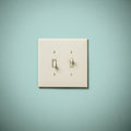 Double Lightswitch on Blue Green Aqua Teal Wall On and Off Stock Image