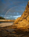 Double rainbow with face cliff in foreground Royalty Free Stock Photo