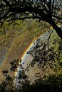 Double rainbow in the mist of Victoria Falls, Zimbabwe Africa. Royalty Free Stock Photo